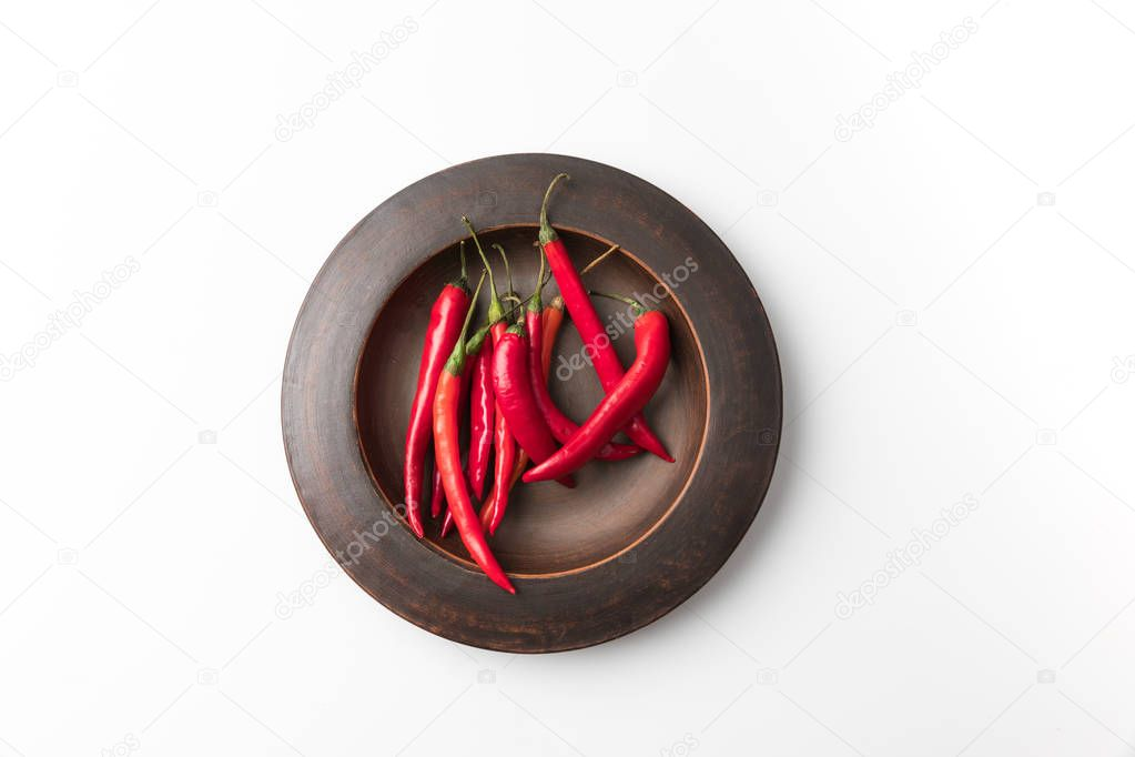 red chili peppers on black plate