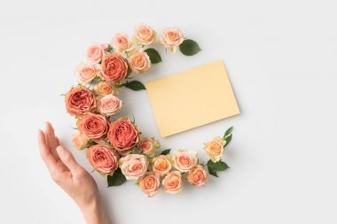 Envelope surrounded by beautiful pink flowers with hand isolated on white stock vector