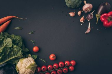 top view of raw vegetables on gray table