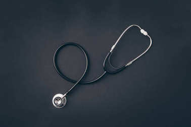 top view of stethoscope on gray surface