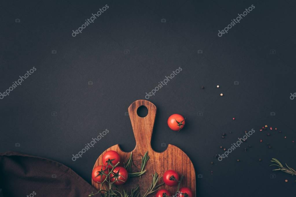 top view of cherry tomatoes and fennel on gray table