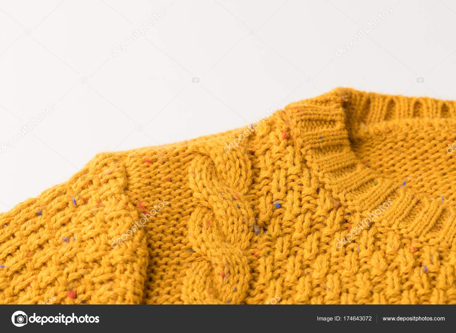 вязаный желтый свитер с узором стоковое фото Antonmatyukha