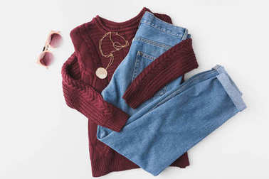 knitted sweater, trendy jeans and accessories