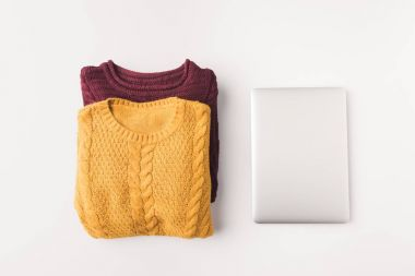 knitted sweaters and laptop