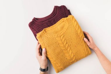 hands with knitted sweaters