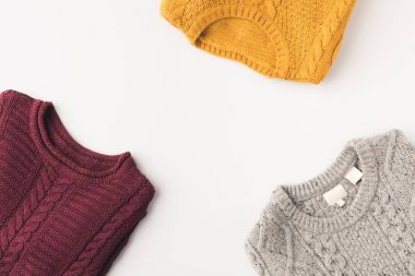 grey, burgundy and yellow sweaters