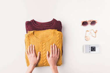 sweaters and smartphone with uber appliance