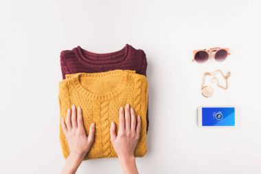 sweaters and smartphone with shazam appliance
