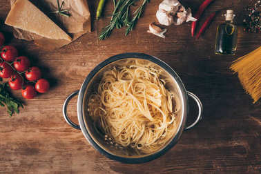 top view of spaghetti pasta and ingredients on wooden tabletop