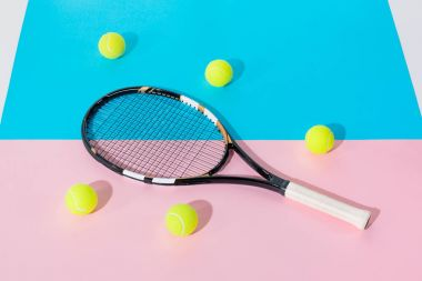 Tennis racket and yellow balls on blue and pink papers stock vector