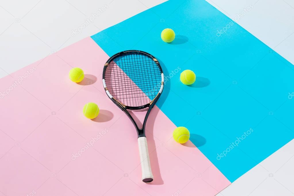tennis racket and yellow balls on blue and pink papers
