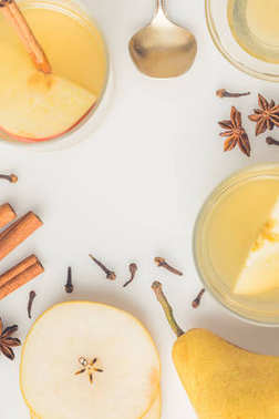 top view of delicious cider with spices on white surface