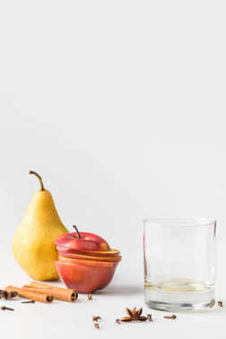 Empty glass with apple and pear on white surface stock vector