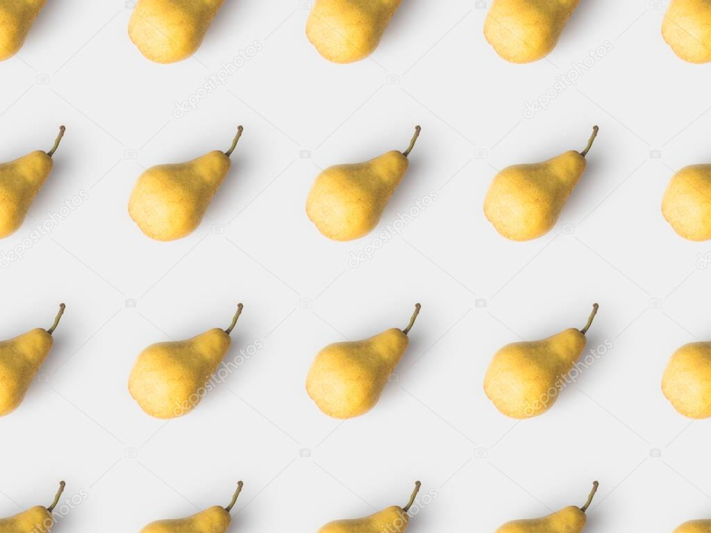 repetitive pattern of yellow pears isolated on white