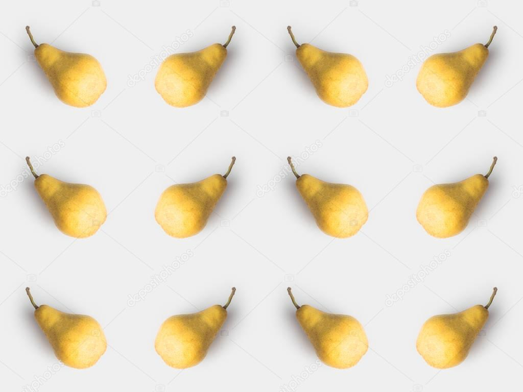 pattern of fresh yellow pears isolated on white
