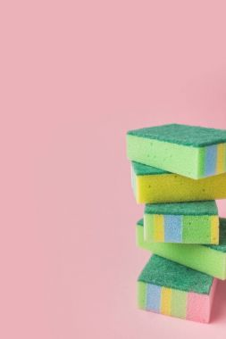 pile of colorful washing kitchen sponges, on pink