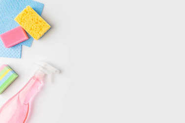 Top view of colorful washing sponges and spray bottle, isolated on white stock vector