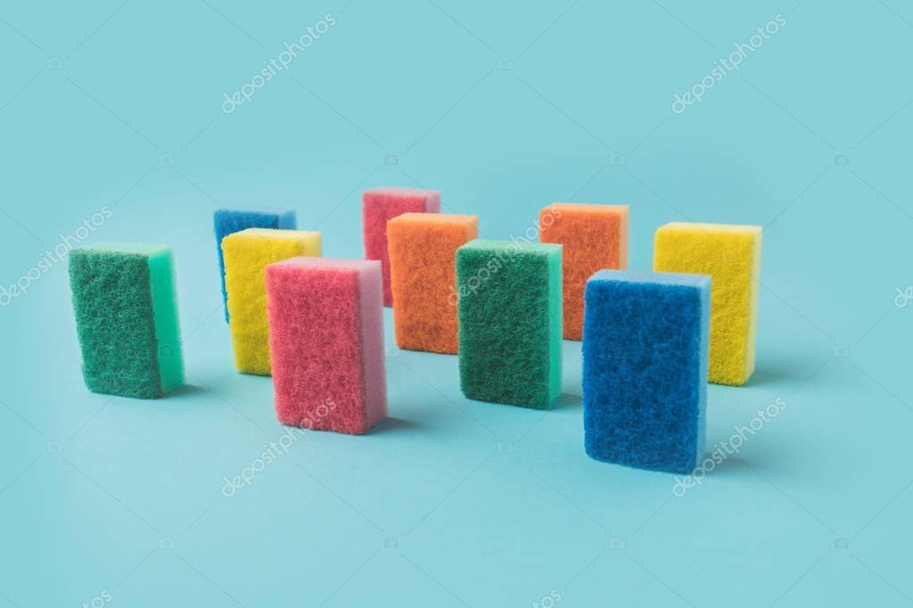 studio shot of colorful washing kitchen sponges, on blue