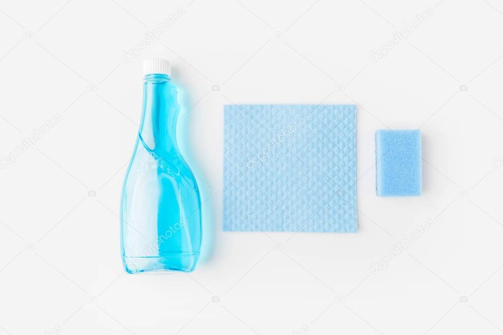 top view of blue bottle and washing sponges, isolated on white
