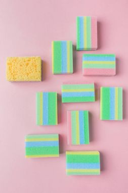 top view of colorful washing sponges, on pink