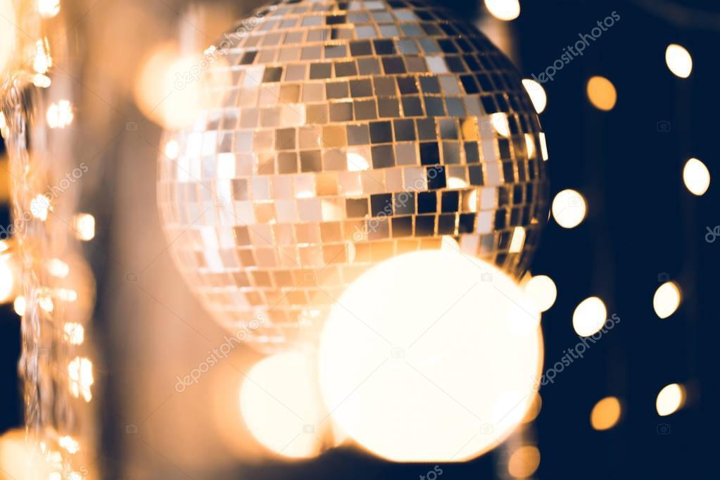 classic disco ball with christmas lights around