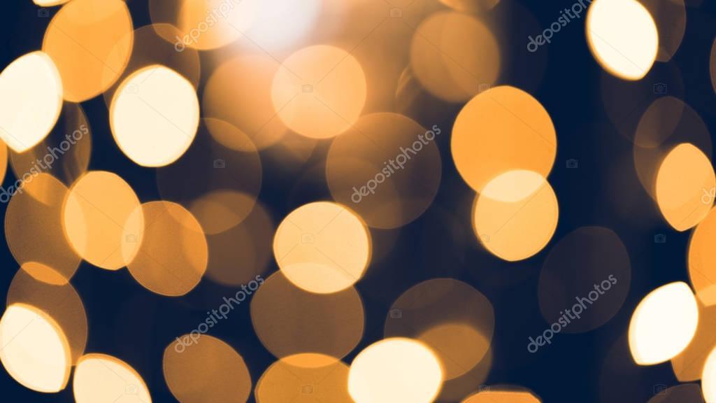 beautiful golden bokeh on black background
