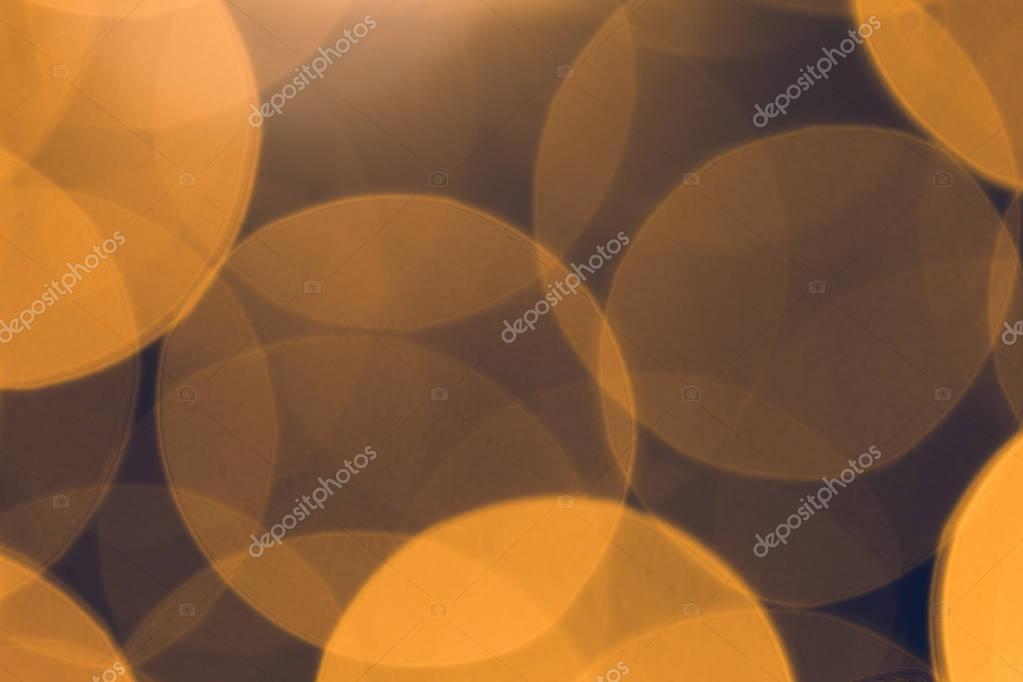 beautiful golden bokeh on dark background
