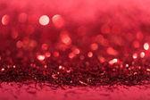 Vánoční pozadí s červenými lesklými rozmazané konfety