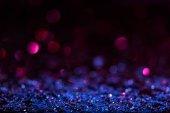 karácsonyi háttér a kék és rózsaszín homályos fényes konfetti csillag