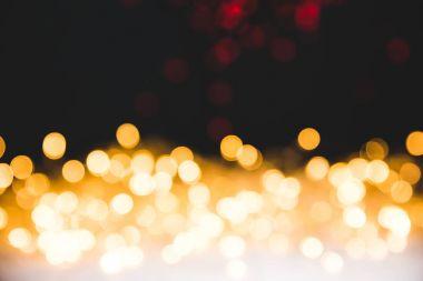 Golden bokeh lights on dark christmas background stock vector