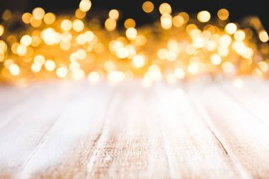 festive bokeh lights on wooden surface, christmas decor