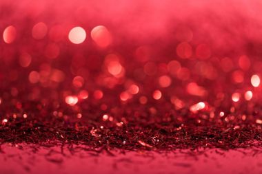 christmas background with red shiny blurred confetti