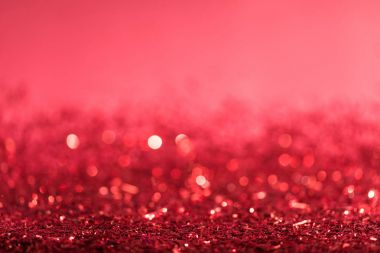 christmas background with red shiny confetti with bokeh