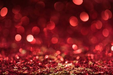 Christmas background with red shiny confetti stars with bokeh stock vector