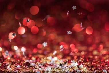 Christmas background with falling red and golden confetti stars stock vector