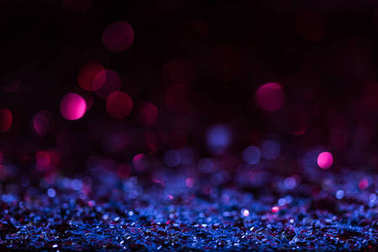 christmas background with blue and pink blurred shiny confetti stars