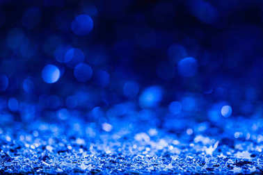 christmas background with blue blurred shiny confetti stars