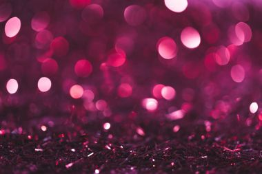 christmas background with pink and purple shiny confetti