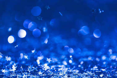 christmas background with falling blue shiny confetti stars