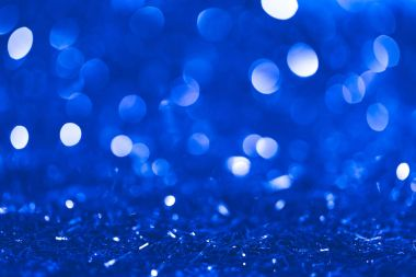 christmas blue blurred shiny confetti with bokeh