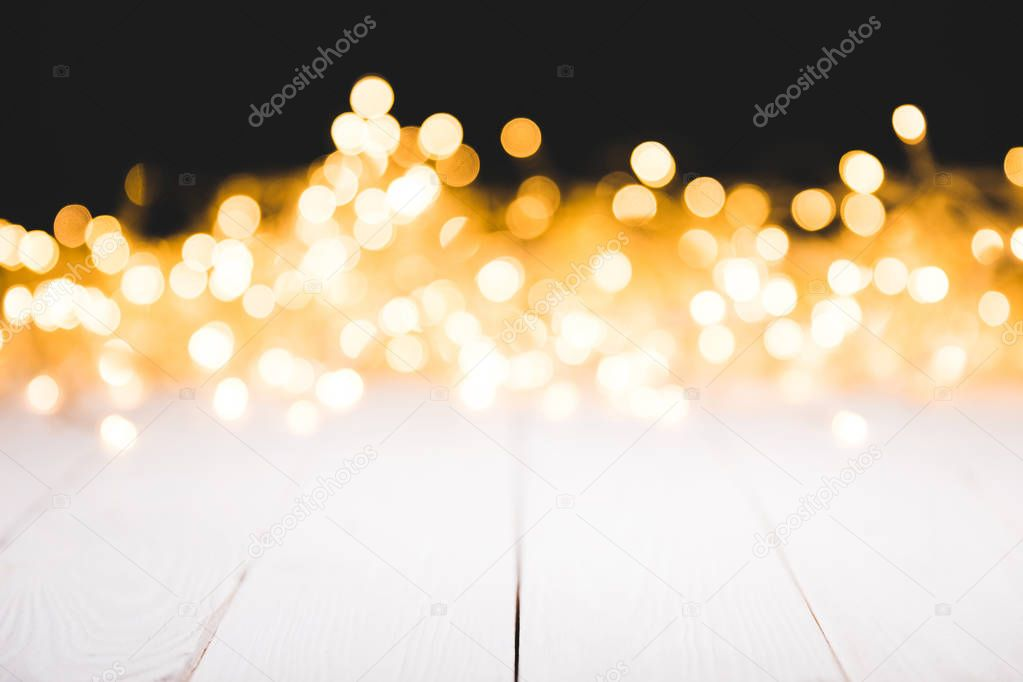 festive bokeh lights on white wooden surface, christmas background