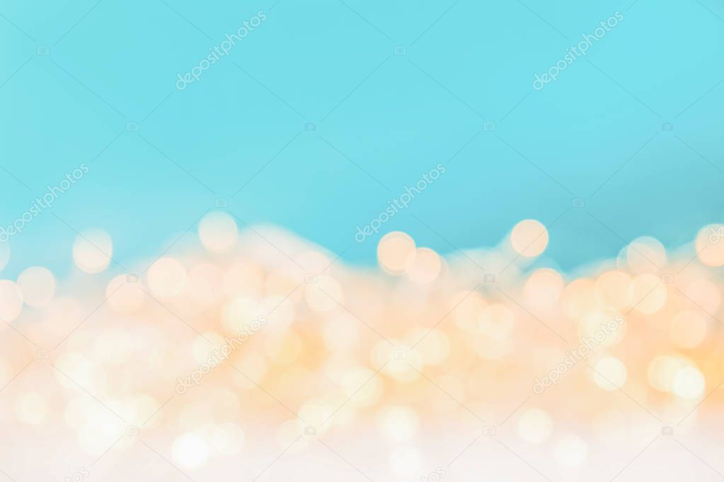 shiny christmas bokeh lights on blue background