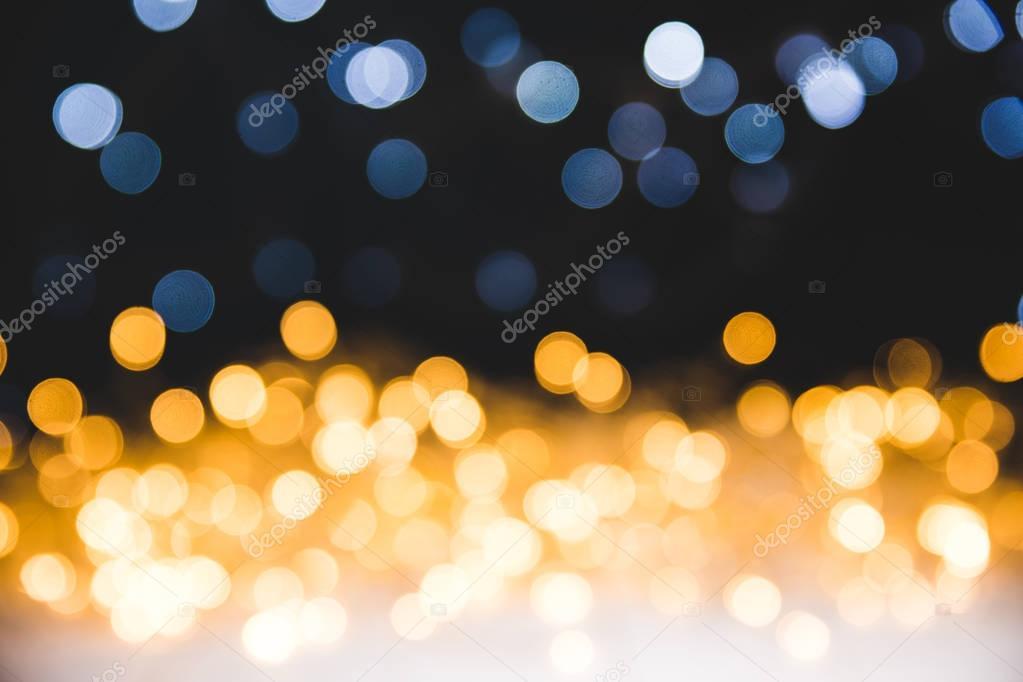 christmas golden bokeh lights on dark background