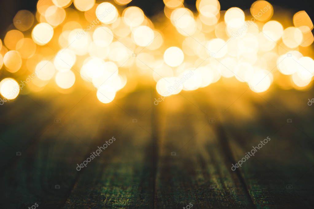 festive bokeh lights on wooden surface, christmas background