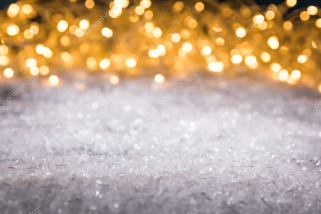 christmas winter background with snow and shiny blurred lights