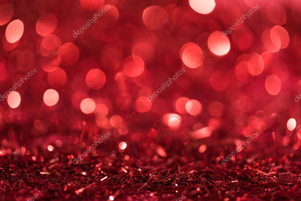 christmas background with red bright blurred confetti