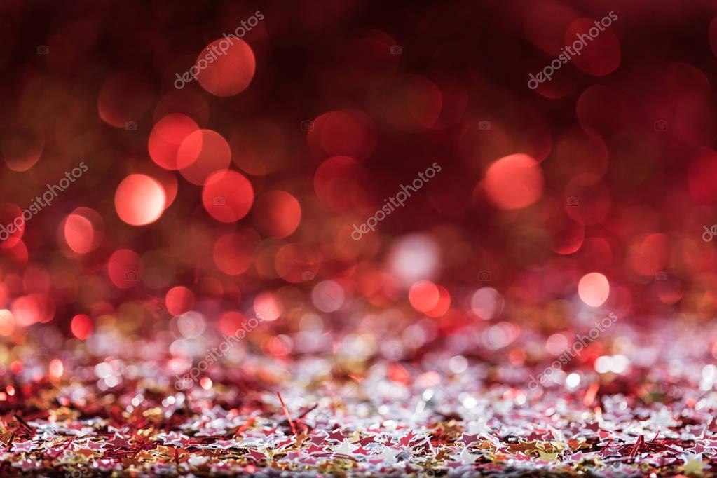 christmas background with red bright confetti stars