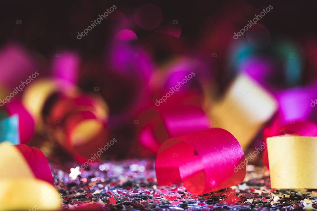 colorful christmas confetti and shiny stars with blurred background