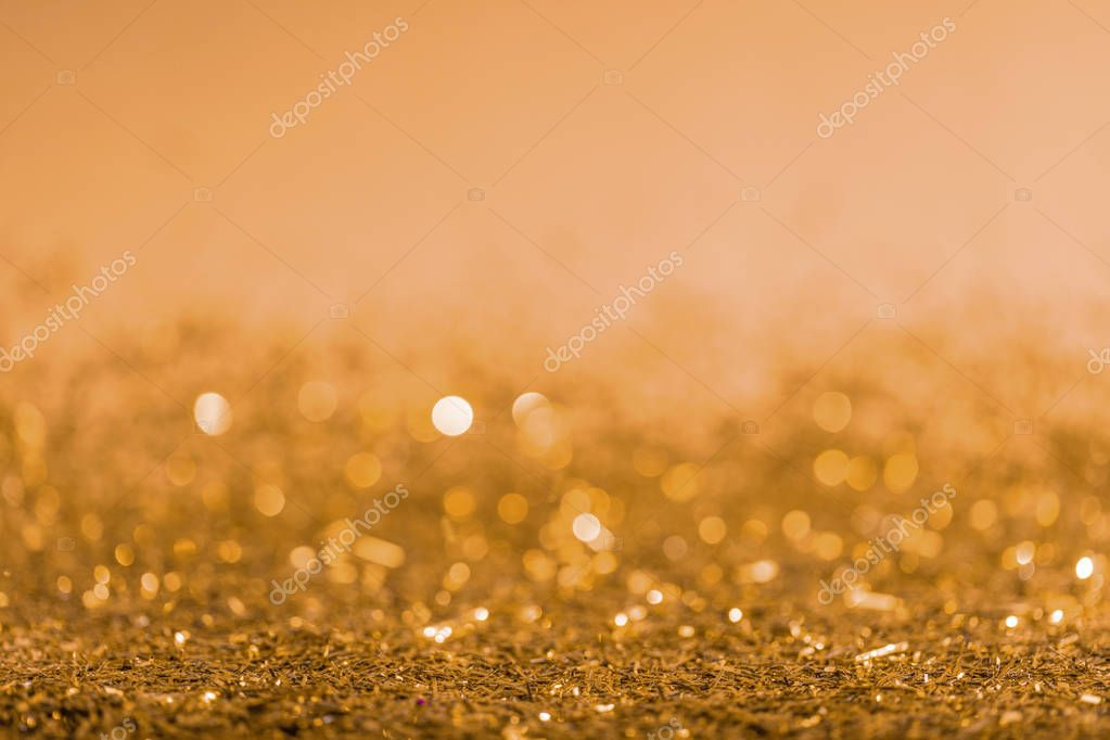 christmas background with golden shiny blurred confetti
