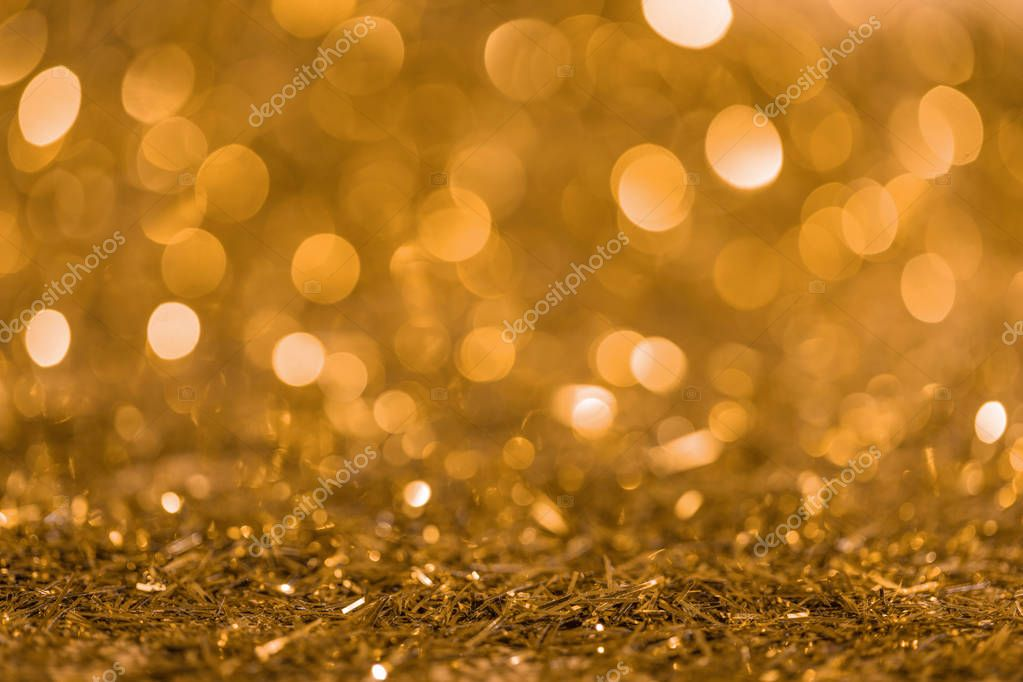 christmas texture with golden shiny blurred confetti